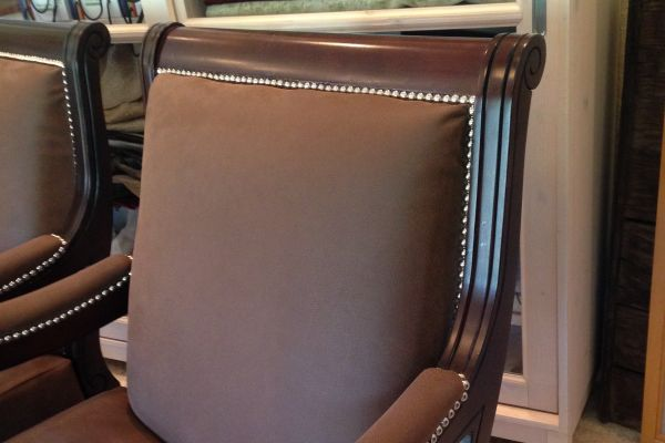 faux-saude-leather-chairs-close-up-after-318915227-C471-FC40-4885-F8C02BEA5CA8.jpg